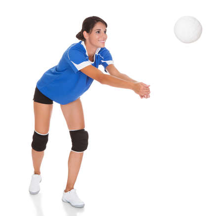 volleyball: Happy Woman Holding Volleyball Over White Background