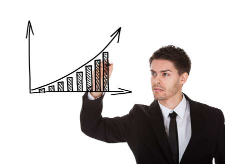 Man holding marker writing profit growth chart on white screen photo