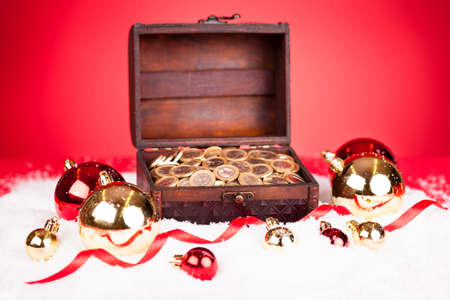 Euro Coins In Treasure Box With Christmas Bauble Around photo