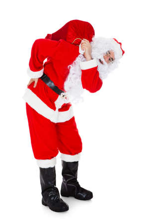 human back: Portrait of santa carrying sack over white background