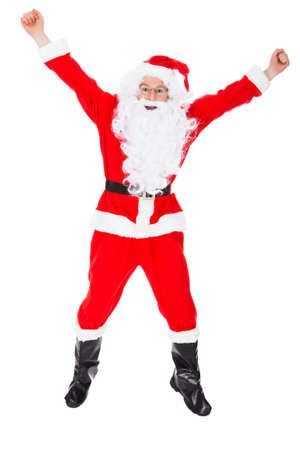 Portrait of excited santa raising his arms on white background