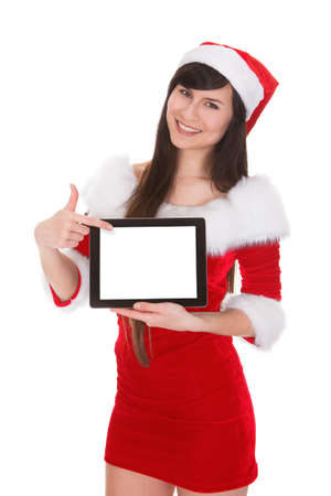 Female Santa Holding Tablet On White Background photo
