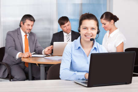 Portrait Of Female Customer Care Executive Working At Office photo