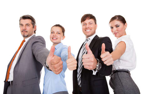 Group Of Businesspeople Standing In A Row Showing Thumb Up Sign photo