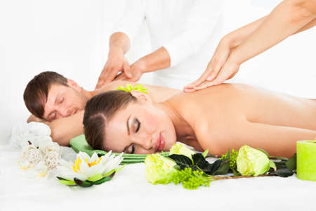 Attractive Couple Lying Side By Side Enjoying Spa Treatment photo