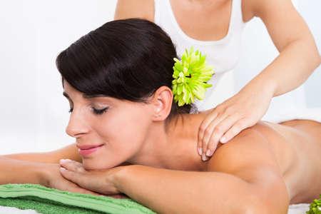 Woman In Spa Salon Lying On Towel photo
