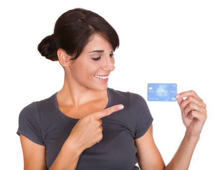 Happy Woman Holding Credit Card Over White Background photo
