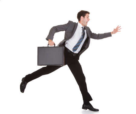 running businessman: Businessman Running With Briefcase In Hand On White Background