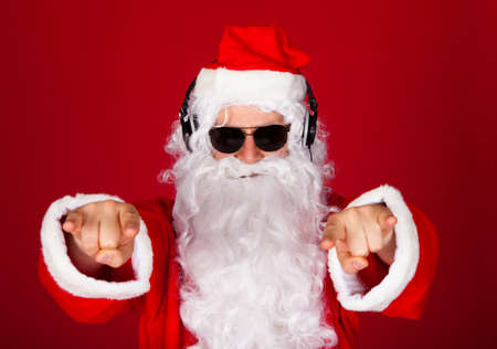 christmas music: Portrait of a santa listening music and gesturing Stock Photo