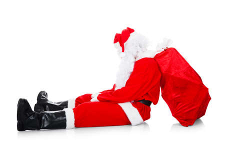unhappy people: Portrait of tired santa over white background