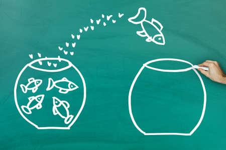 empty tank: Fish escaping into empty tank on green blackboard