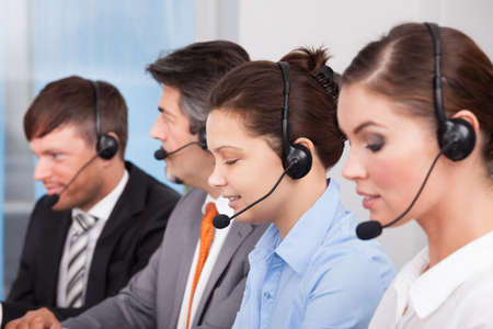 call: Call center operator sitting in row working at office
