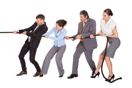 Group Of Businesspeople Pulling Rope Over White Background photo