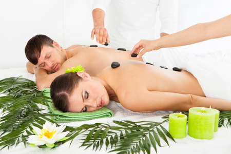 Couple Relaxing In A Spa Getting Lastone Therapy photo