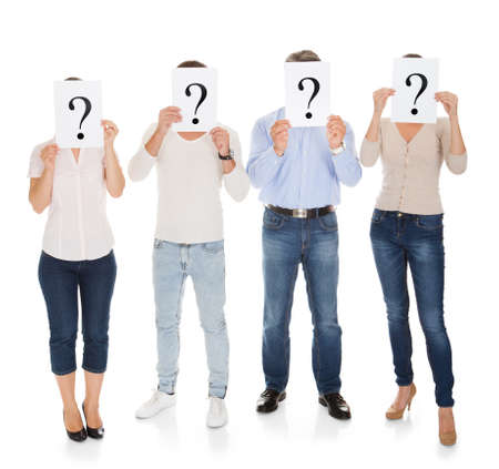 Group Of A People Holding Question Mark Sign In Front Of Their Face