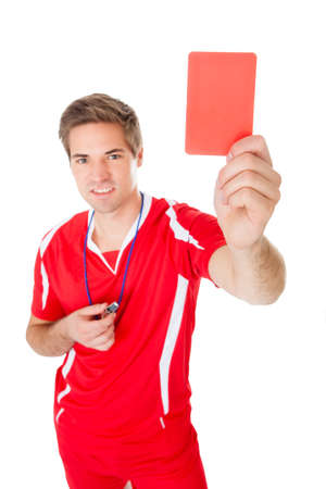Portrait Of Male Soccer Referee Holding Red Card photo