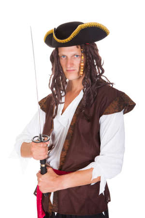 Portrait Of A Young Pirate Holding Sword On White Background photo