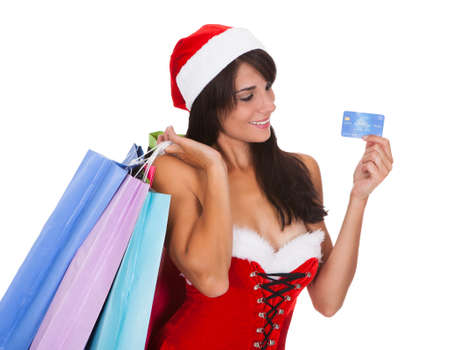 Young Woman With Shopping Bags And Showing Credit Card Over White Background photo