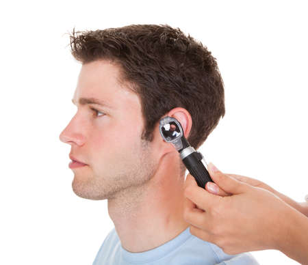 otoscope: Close-up Of A Doctor Examining Patients Ear With An Otoscope