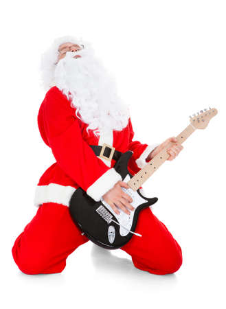 melodist: Portrait of a santa playing guitar over white background