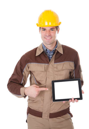 Happy Male Construction Worker Holding Digital Tablet On White Background photo