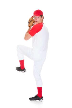 baseball pitcher: Portrait Of Baseball Pitcher Isolated On White Background