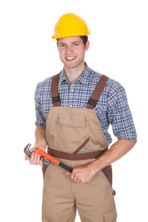 Happy Male Worker Holding Wrench Isolated On White Background photo