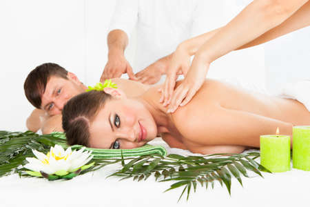 lying on side: Attractive Couple Lying Side By Side Enjoying Spa Treatment