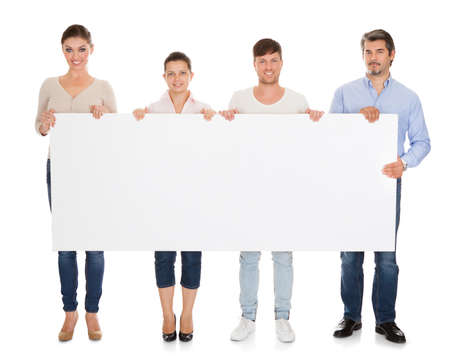 blank banner: Group Of People Holding Placard Over White Background Stock Photo