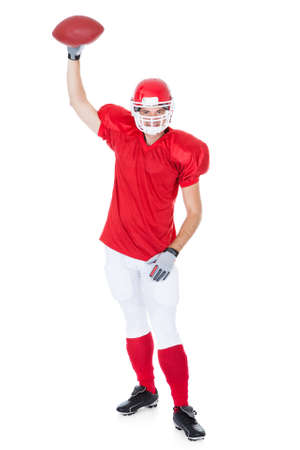 American Football Player Holding Rugby Ball On White Background photo