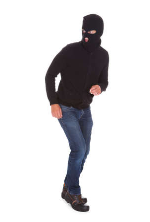 Portrait Of A Burglar Standing Isolated On White Background Stock Photo