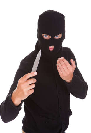 Burglar Man In Balaclava Holding Knife Isolated On White Background photo