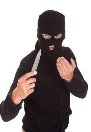 thievery: Burglar Man In Balaclava Holding Knife Isolated On White Background Stock Photo