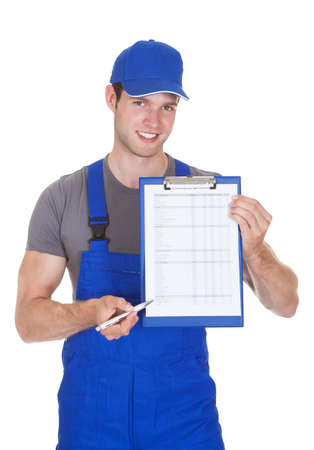 auto service: Young Construction Worker Showing Clipboard Over White Background Stock Photo