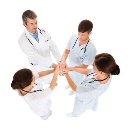 pledge: Overhead Photo Of Doctors Stacking Hand With Coworkers Stock Photo