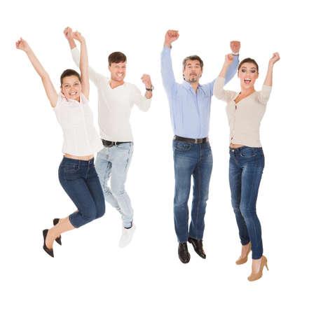 Groupe d'un heureux amis debout sur fond blanc Banque d'images - 23731584
