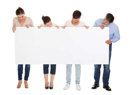Group Of People Holding Placard Over White Background photo