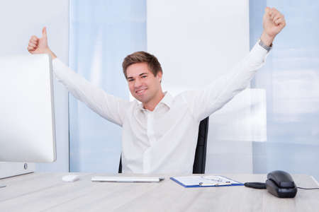 raised hand: Happy Young Successful Businessman Raised Hand With Thumb Up