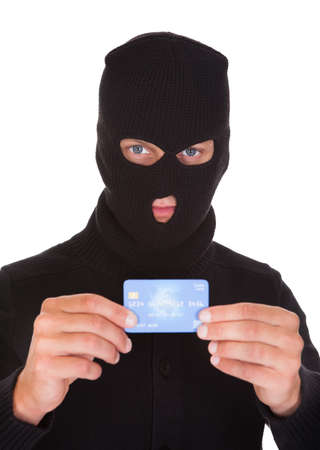 Portrait Of A Burglar Putting Credit Card photo