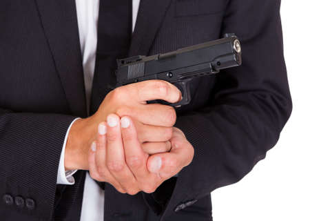 Close-up Of A Male Spy In Suit Holding Handgun photo