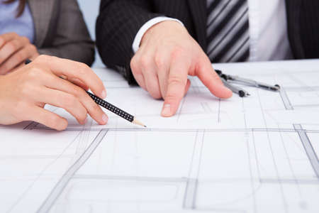 construction draftsman: Closeup Of A Persons Hand Pointing On Blue Print