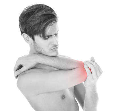 Shirtless Young Man Suffering From Elbow Pain On White Background photo