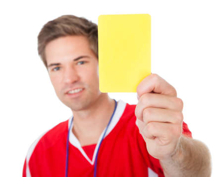 Portrait Of Male Soccer Referee Holding Yellow Card photo