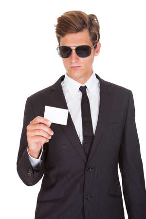 company secrets: Portrait Of Male Spy Wearing Sunglasses Isolated On White Background