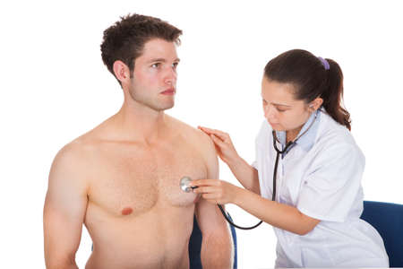 listening to heartbeat: Doctor Listening Heartbeat Of Patient With Stethoscope Stock Photo