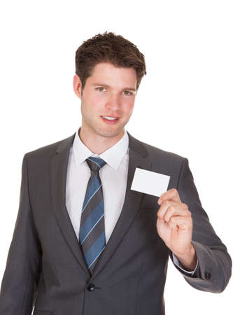 company person: Young Businessman Showing Visiting Card Isolated On White Background