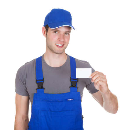 Portrait Of Happy Mechanic In Workwear Holding Visiting Card