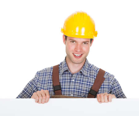Worker Wearing Hardhat And Holding Blank Placard Isolated On White Background