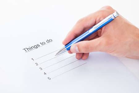 to do list: Closeup on hand filling things to do list Stock Photo