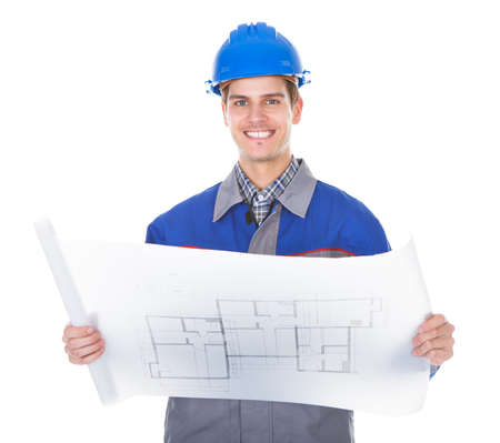 hard worker: Portrait Of A Male Happy Architect Holding Blueprint On White Background Editorial